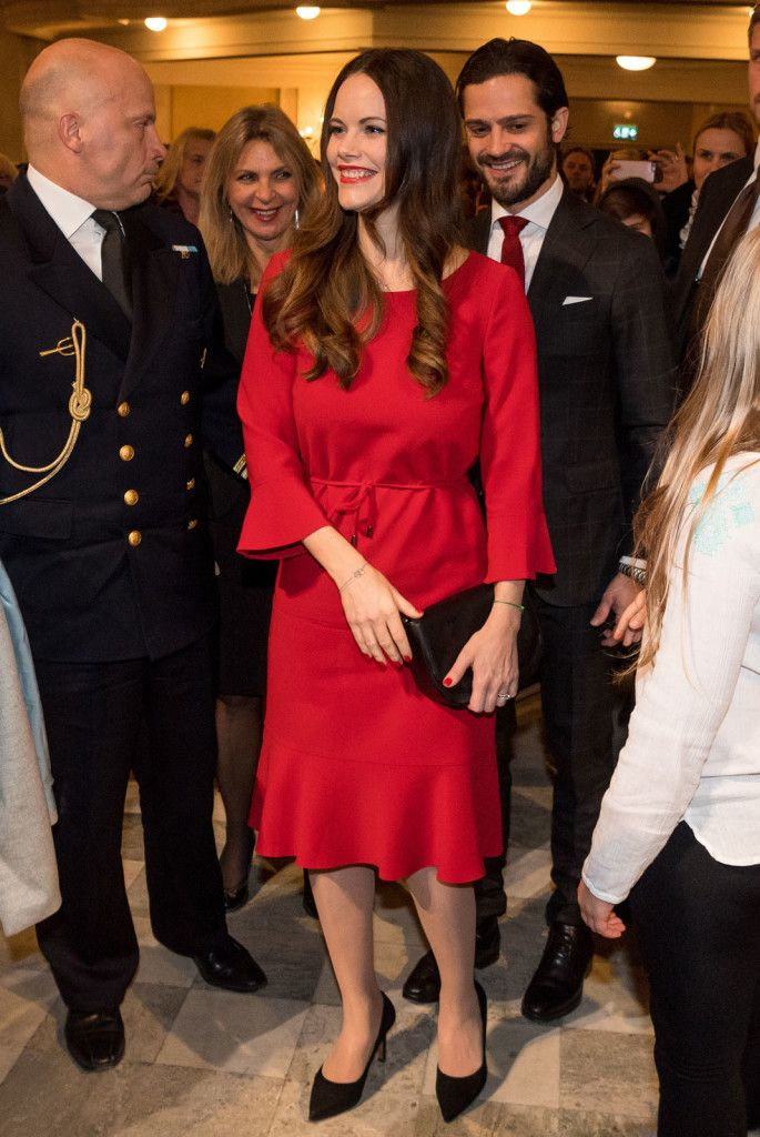 21 December 2017 - Prince Carl Philip and Princess Sofia attend Vasastan Christmas Concert in Stockholm - dress by Hugo Boss