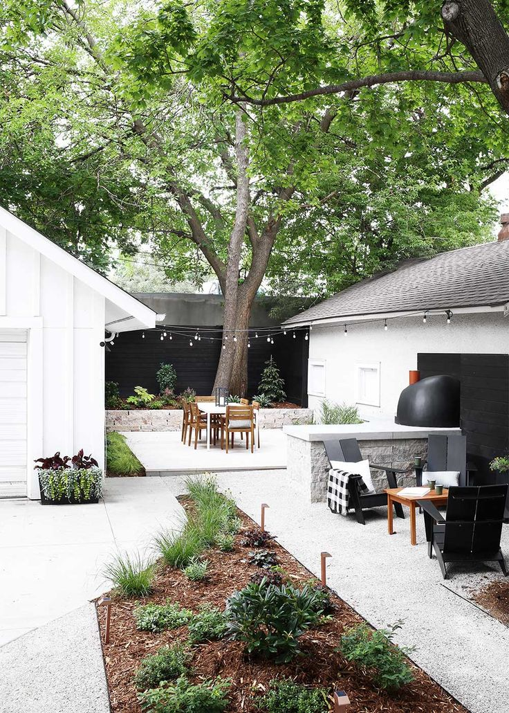 An urban Minnesota Modern backyard design, outfitted with two living spaces  plus a kitchen area