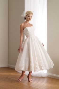 beautiful tea length dress by mon cherie...would look amazing paired with a blue sash and blue high heels