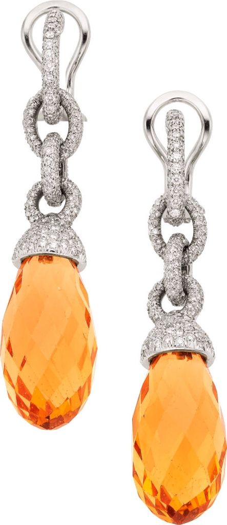GABRIELLE'S AMAZING FANTASY CLOSET   Hang a little ta-da from your ears. Tiffany & Co. Golden Beryl, Diamond, & Platinum Earrings.  