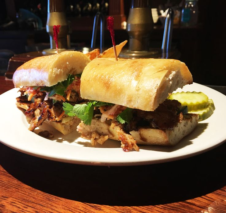 Appalachian Brewing Co.  THE PORK BANH MI Korean BBQ pork loin, seared and served on grilled ciabatta with sliced cucumber and a Vietnamese-style carrot and radish slaw, topped with fresh cilantro and mayonnaise. #PorkSandwich #KoreanBBQ