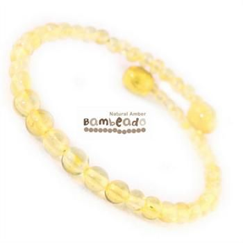 This bracelet is made from round baltic amber in a lemon colour. The bracelet is made from memory wire that retains it's shape when coiled around your wrist (a little like a slinky!). There is no need to fiddle with a clasp.While Bambeado amber comes in several colours, the colour is just a matter of personal choice. The colours may vary slightly from the images on the website due to variations in the amber beads. Each amber bracelet is unique