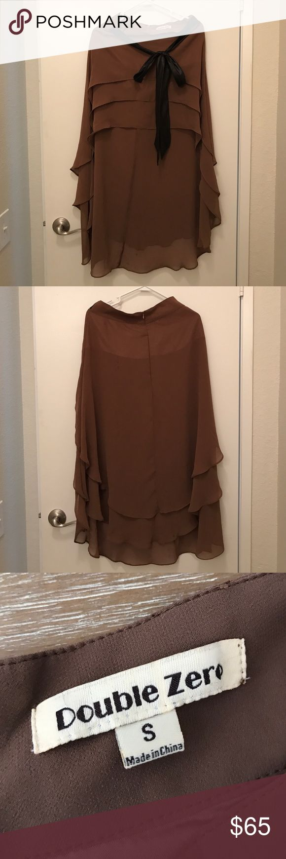 Brown Maxi Skirt Brown Maxi Skirt. Has a black tied up bow. Short in the front, long in the back. Size small. High waisted. Double Zero Skirts Maxi