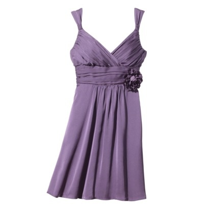 A gorgeous little chiffon dress, with pleated details and a sweet flower at the waist. Put a shrug over it and you're done. Available in seven candy colors including orchid purple. $70 from Target.