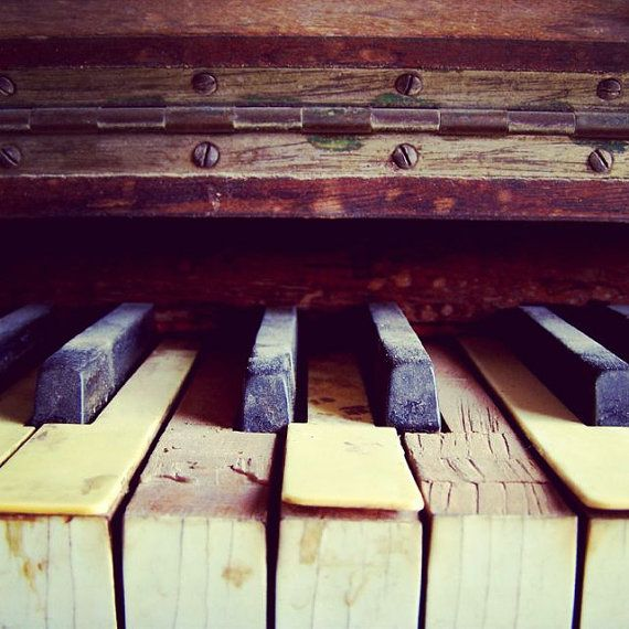 I love the look of old pianos. Though the make me sad that they're worn out, I like to think of all the people that have played them throughout their lifetime.
