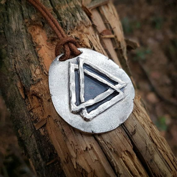 Handmade valknut pendant with a primitive and timeworn design. The pendant is not symmetric. Made of sterling silver. Measures about 1.5x1.5 inches 40x38mm. Weight about 0.63 oz / 18g. Cord that is thread over the head included. Small differences may occur compared to the pictures.