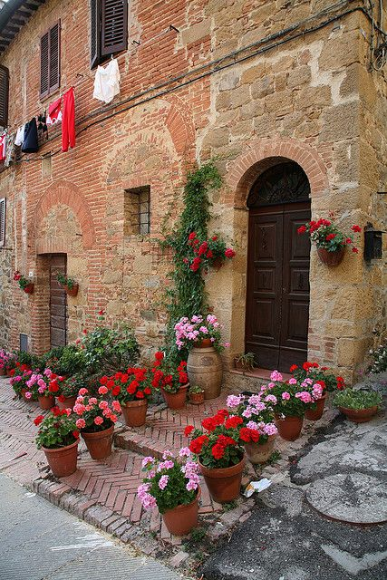 Tuscany, Italy -- WHAT a difference a few pots of flowers can make...I love the barrel!!