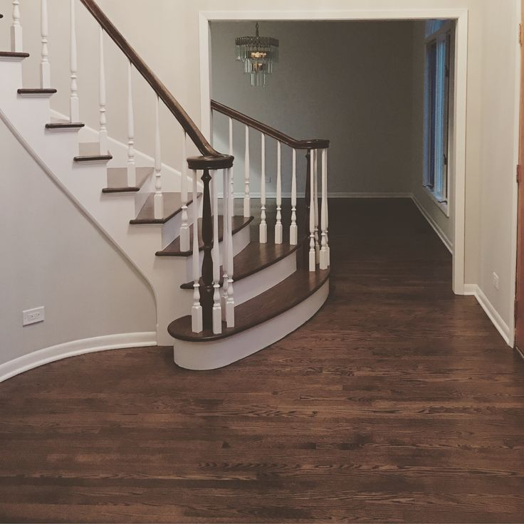 New solid 2 1/4 red oak hardwood floors refinished with one coat of dark walnut stain color and three coats of Swedish finish. (Photo credit to the client) #hardwoodfloors #refinishyourfloors