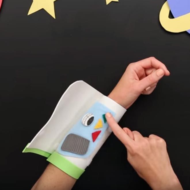 Come in, Star Command! This is Buzz Lightyear with an out of this world DIY Mission Control Arm band craft. Craft this simple arm pad to turn anyone into a Space Ranger!