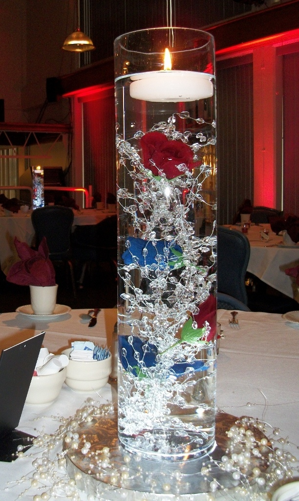 Centerpieces for Military Wedding...with your cranberry color in the glass and blue somewhere ...