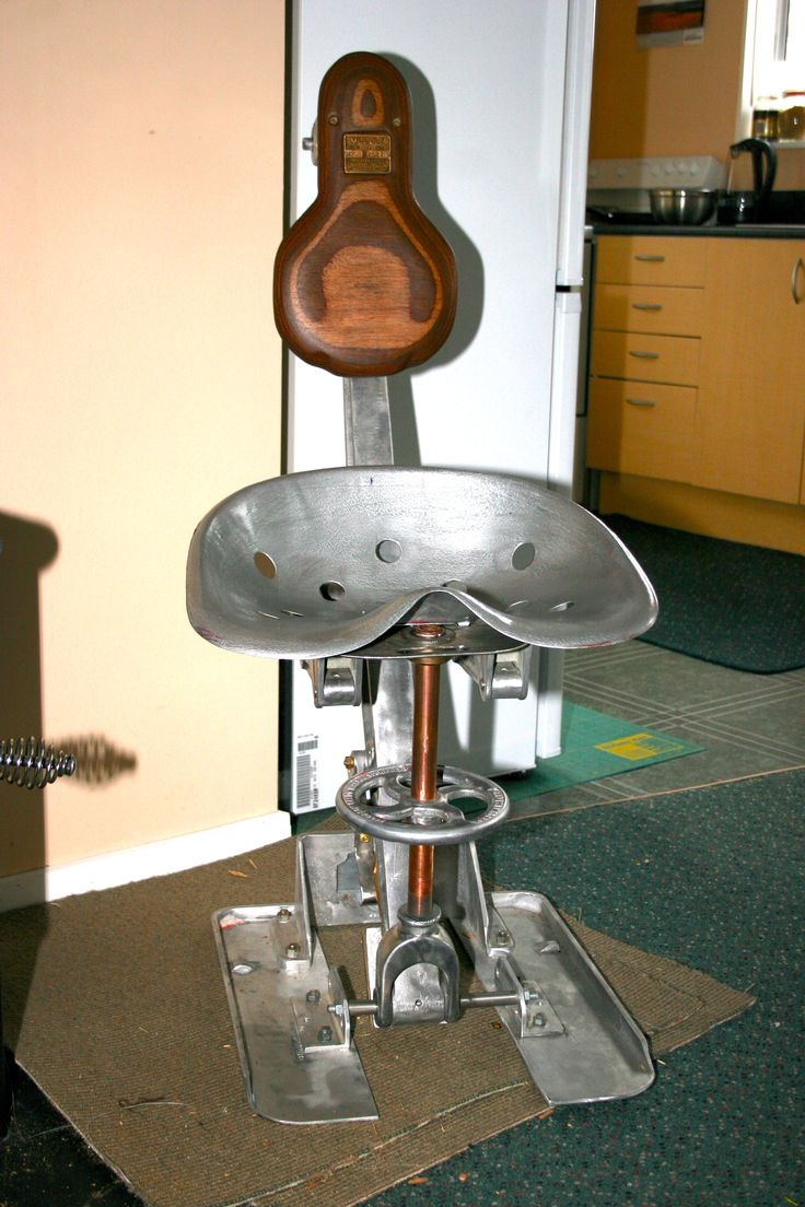 A chair made from parts of an old Patterson Candy control valve from a water treatment plant. The tractor seat was found in a barn. The ply backrest was from old shuttering.