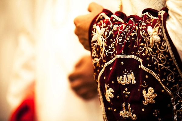 The groom looks resplendent in this armband that is part of the grooms traditional attire at a Bohri wedding. Lifestyle Candid Wedding Photography at The O Hotel, Pune.