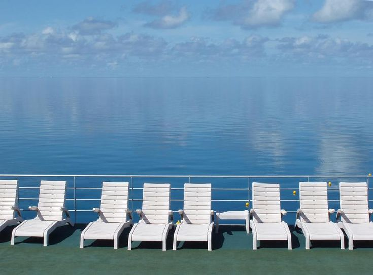 a line of sun loungers and still blue water, great barrier reef, australia - free stock photo from www.freeimages.co.uk