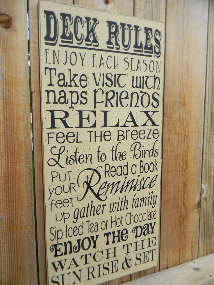 Deck Rules typography large wood cream sign