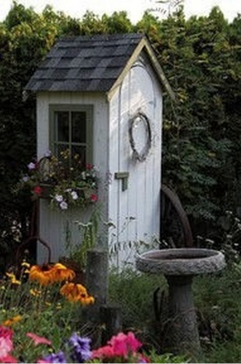 Okay, this is my fav outhouse turned into garden shed.