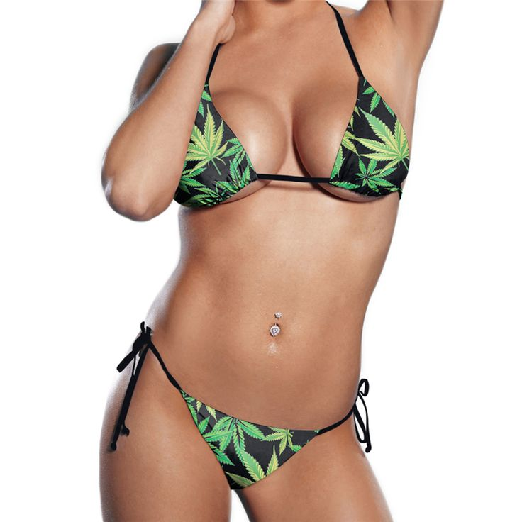 In stock green leaves mature woman bikini