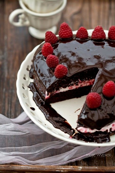 Chocolate cake with raspberry whipped cream and chocolate ganache