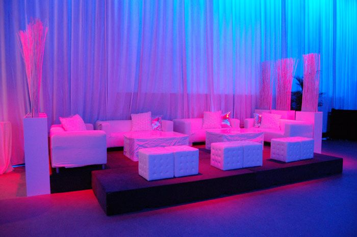 White lounge furniture provided seating in the Artifacts Room, used for the cocktail reception and an after-party sponsored by Air...
