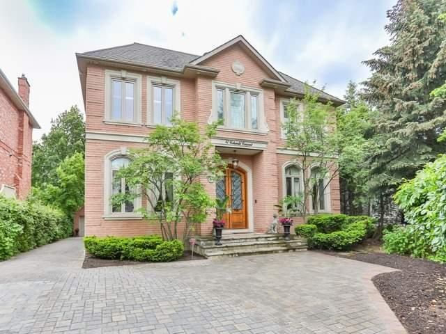 Custom Home In Prestigious St. Andrews Enclave. Fab Location. Gorgeous Treed 60' Lot. Classic Georgian W/Precast Stone Accents. Dbl Front Door W/Decorative Wrought Iron Leads To 2 Sty Foyer W/Magnificent Skylight. Lrg Principal Rms, Gourmet Kit Boasts Center Island, Brkfst Area & W/O Approx 4100 Sq.Ft.+2100 Sq.Ft. Fin Ll Complete W/Rec, Media, Exercise, Bdrm & Bathrm. Spectacular Fully Landscaped Yard W/Pool, Waterfall, Cabana & Outdoor Kit. Dbl Det Garage
