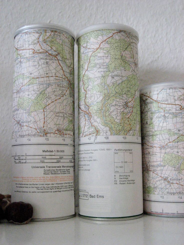 Perfect storage for my craft room/office: its Pringles cans wrapped in USGS Maps