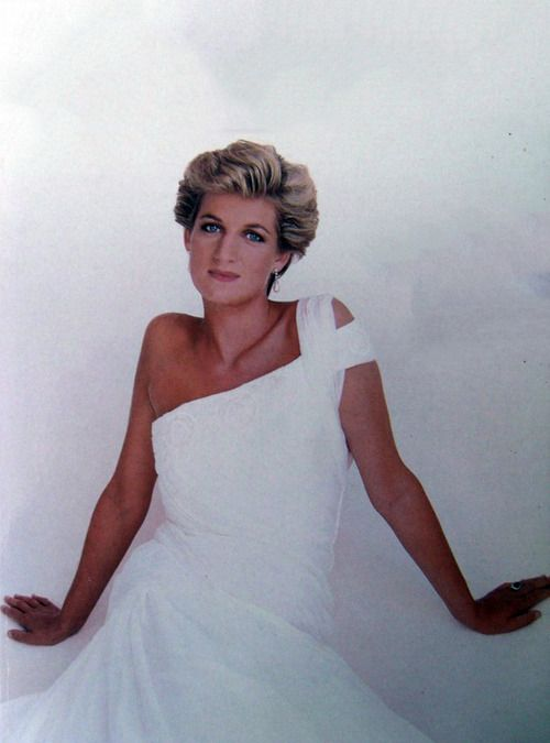 One shoulder white sari inspired chiffon dress trimmed along the top with pearlised sequins and beads. Designed by Gina Fratini. Diana wore this on a few occasions, one of them to a ballet in Rio De Janeiro.