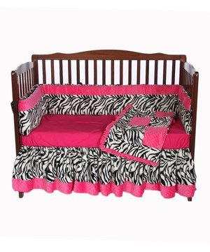 Create a lively atmosphere in the nursery with this vibrant bedding set that's comfortable as it's eye-catching. Featuring bright hues and a wild zebra pattern, this set comes with a comforter, bumper, crib skirt and sheet in coordinated colors.