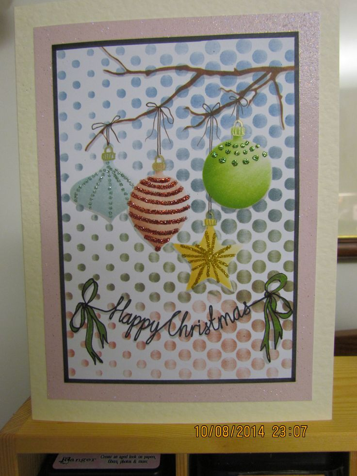 "I made this card using Clarity Dotty Wave & Wheelie Bauble & Branch stencils &""Happy Christmas"" stamp tied off with hand-drawn cotton & ribbon bows. Coloured with distress inks and markers and finished off with some glitter for a bit of sparkle"