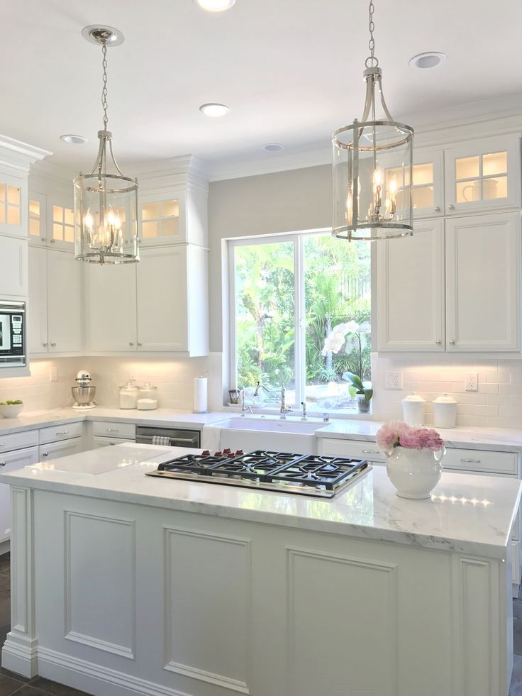 white kitchen with danby marble and subway tile backsplash with added stacked cabi kitchen on kitchen ideas white id=41840
