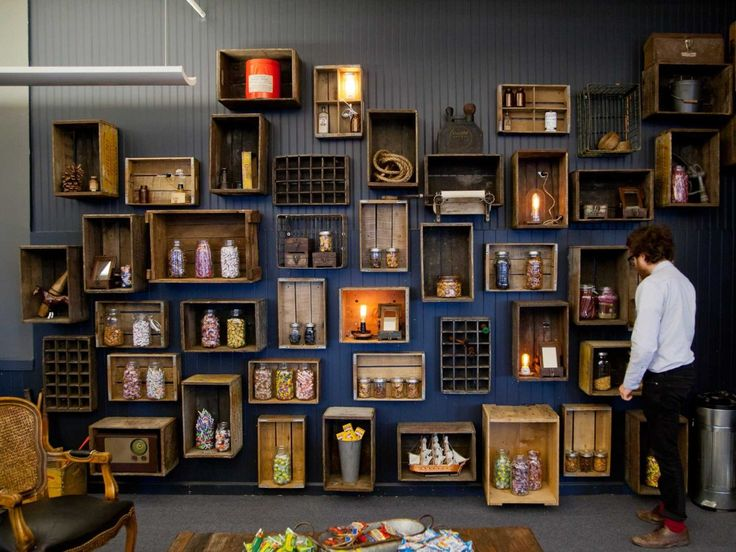 This awesome office has this featured wall with old wooden boxes as shelves. Great look!