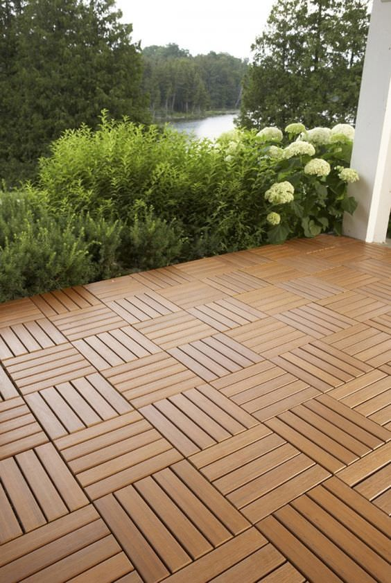 Want modern and clean looking patio flooring? 'Build Direct' has these interlocking deck tiles that do the job, again, right over existing concrete!