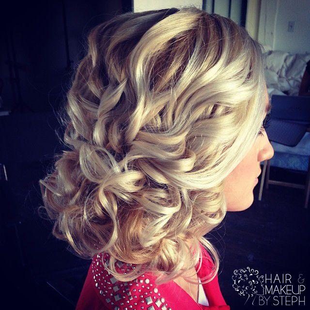 Curling wedding hair.