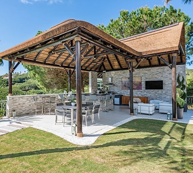 Thatched Outdoor Kitchen And Entertainment Area For A Private Client In Sotogrande The Perfect Setting For Summer Gazebo Plans Thatched House Thatched Roof