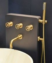 Acme wall mounted bath mixer and flexi handshower kit scuffed brass