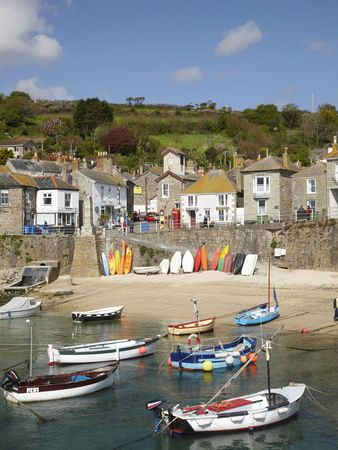 "Mousehole: ""Despite the inevitable conflict between narrow, twisting streets and motor vehicles, second homes and tourist trade, the cosy, cottagey good looks and picturesque harbour have remained intact."" www.bradtguides.com"