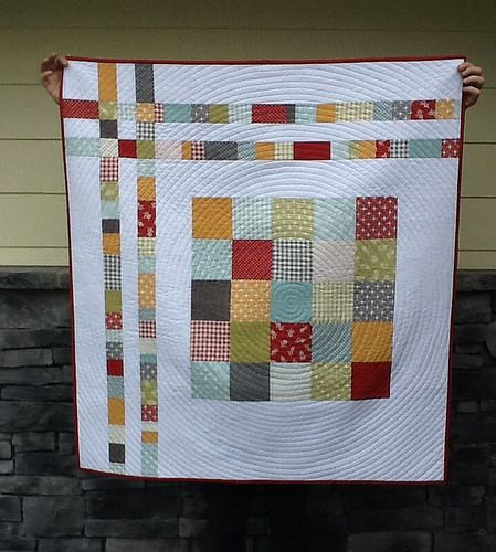 'The World's Not Flat' quilt - Moda Charm pack Flats Marmalade Squares (Two) pattern by Katie @ SwimBikeQuilt and spiral quilting inspired by AmandaJean @ CrazyMomQuilts