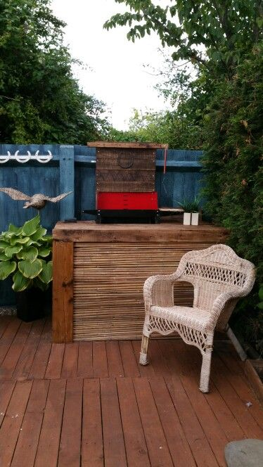 Pallet bbq grill area, a great way to make a cheap bbq stand out!!