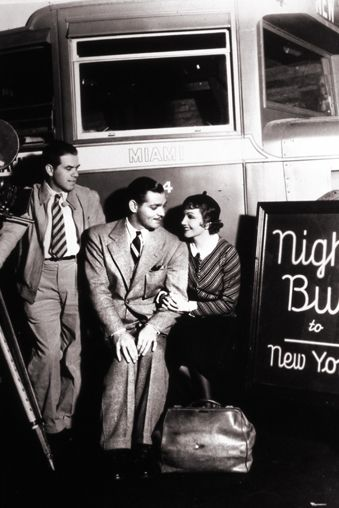 Frank Capra (Director), Clark Gable and Claudette Colbert on the set of IT HAPPENED ONE NIGHT (1934).