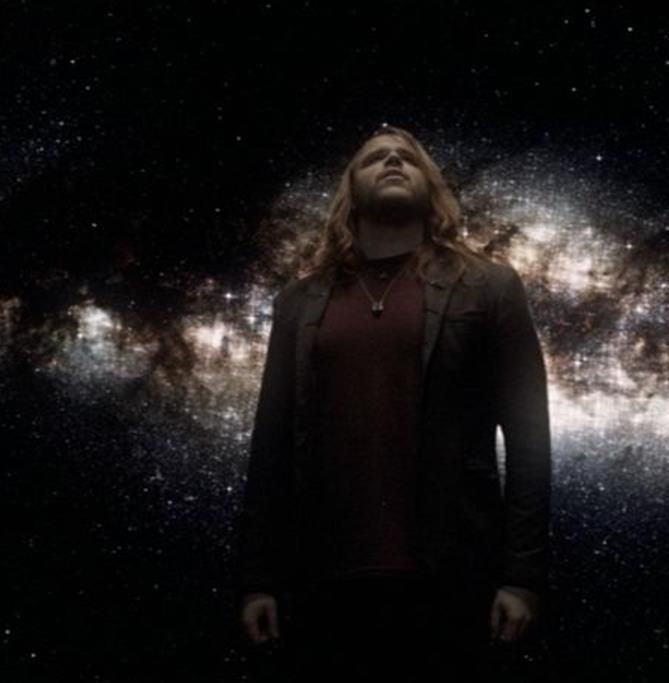 """Caleb Johnson's debut single, """"Fighting Gravity,"""" was initially conceived as a traditional love song."""
