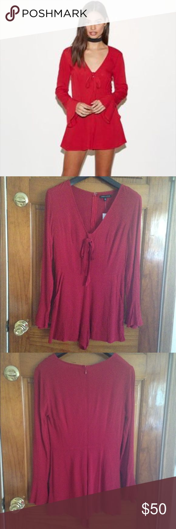 New Listing! NWT Kendall & Kylie romper NWT Kendall & Kylie deep-v long sleeve romper size Small originally $49.95. Includes a removable tie fabric near the top of the v-neck. Note I draw through the barcode so it can't be returned. Kendall & Kylie Pants Jumpsuits & Rompers