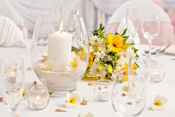 Classic yellow and white with a splash of pink decor wedding setting example at Currumbin RSL in the Event Room.