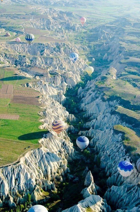 Cappadocia, Turkey. I would love to balloon over that. Our friends are getting married in a hot air balloon, i should suggest here...