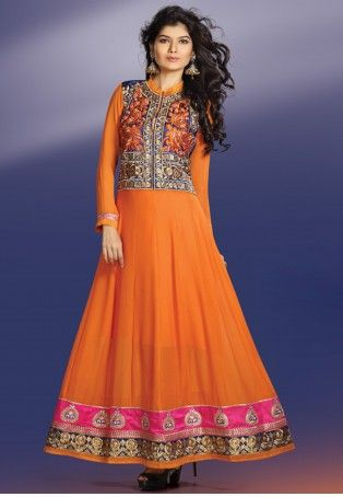 Orange And Navy Blue Georgette, Satin Anarkali Suit Georgette Anarkali in Orange with navy blue satin bodice heavily embroidered in thread, embellished with stone in front and Back. The embroidery pattern on bodice is patterned to make it look like a Jacket. The bottom is panelled with embroidered lace in Zari and stones. This Anarkali Kurta is coordinated with crepe churidar and chiffon dupatta.