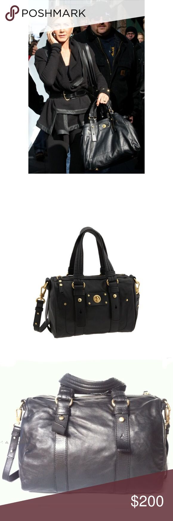 MBMJ Totally Turnlock Shifty Handbag🔅SALE🔅 Beautiful supple black large handbag. Leather, gold accents (one tiny design only grommet on front of bag is missing, hence the low price). Removable cross body strap, inside has pockets & signature Marc Jacobs logo. Authentic, no trades. Comes with MBMJ duster. Marc by Marc Jacobs Bags