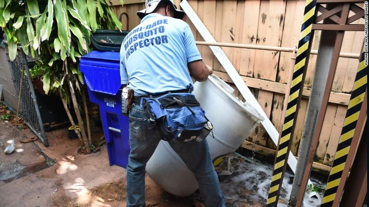 Miami-Dade mosquito control worker Carlos Vargas dumps a barrel of standing water, which can be a source of Zika-carrying mosquitoes.
