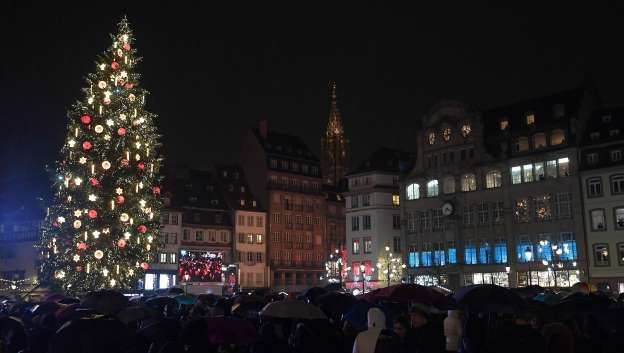 FRANCE   Visitors gather near a Christmas tree in Strasbourg, eastern France, on November 24, 2017, on the opening day of the city's Christmas market, one of the country's oldest of its kind   photo: Frederick Florin/AFP/Getty Images
