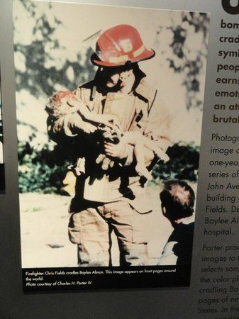 Charles Porter's photograph of firefighter Chris Fields holding the dying infant Baylee Almon .