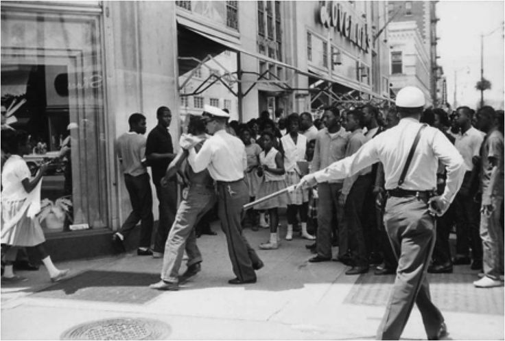"""Birmingham Police taking physical action against nonviolent protestors. (""""God Of Our Weary Years: Birmingham in 1963 – Anna Julia Cooper Project – Anna Julia Cooper Project."""" Anna Julia Cooper Project. N.p., n.d. Web. 20 Oct. 2013.)"""