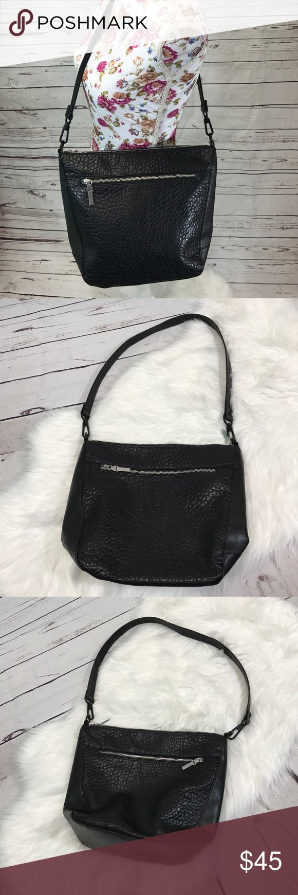 French Connection black textured purse French Connection black textured purse.  Silver hardware. Two outside compartments. Blue interior.  Gorgeous purse!  *Descriptions are described to best ability but please do not hesitate to ask questions if more information is needed. Colors may vary slightly to lighting and photos.*  No modeling, no trades.  Y18 French Connection Bags Shoulder Bags
