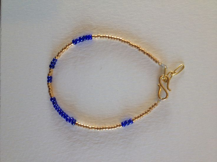 Gold and blue bracelet made to order. Goldtrim is 925 silver goldplated