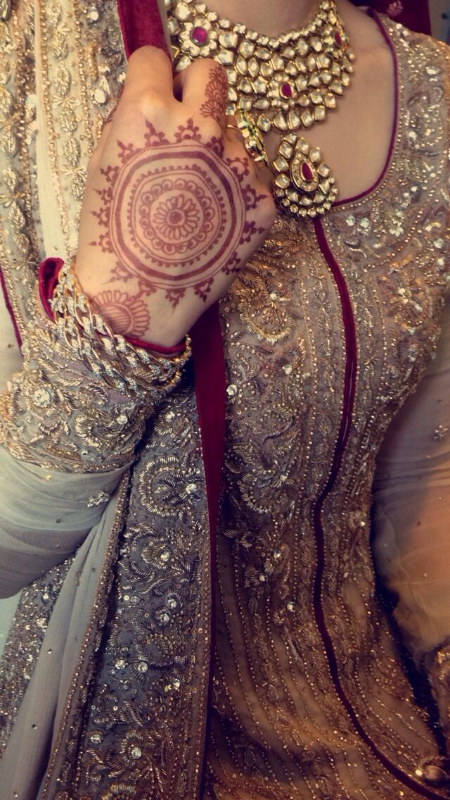 Zardozi Shaadi. Maybe white with gold work and red piping?
